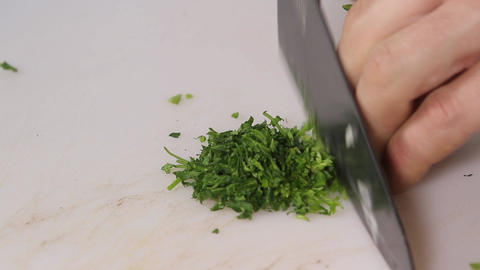Chef chops parsley Footage