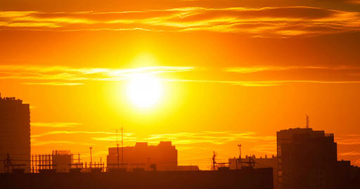 Silhouette of city on sunset background.Time Lapse 画像