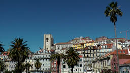 Europe Portugal Lisbon colorful cityscape including cathedral seen from river Footage