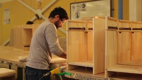Man assembling furniture Footage