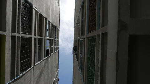 low angle shot of downtown apartment building with blue sky Footage