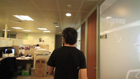 Man walks thru office Footage