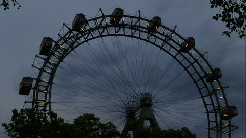Viennese Giant Ferris Wheel at sunset in time lapse Live Action