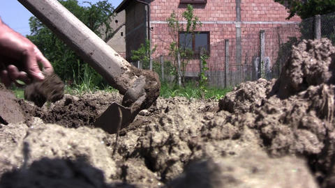 Gardener digging the ground. To have a healthy garden and a bountiful harvest, d Footage