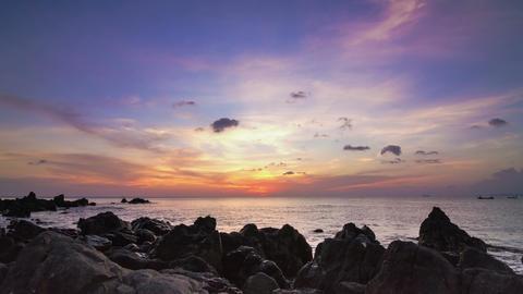 Sea sunset on rock shore pan time lapse Footage