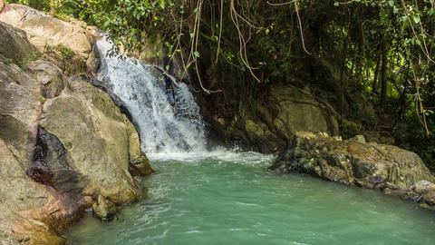 Tropical waterfall with mini lake loop Footage
