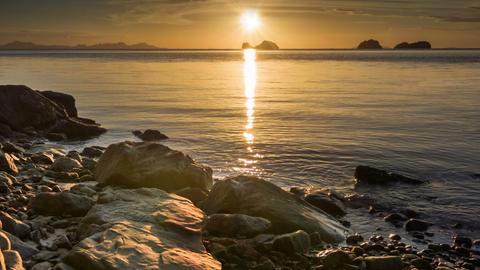 Calm sea at sunset rocks beach Footage