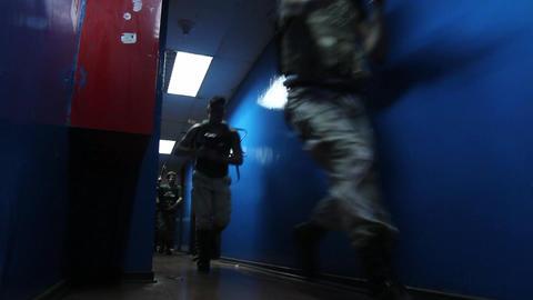 Actors run down hallway Live Action