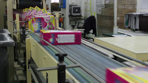 Detergent boxes on conveyor belt Live Action