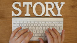 Writing a story with keyboard concept ビデオ