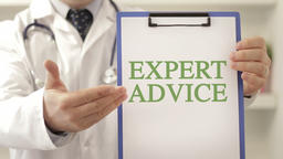 Doctor with expert advice sign Footage