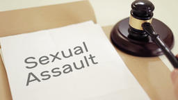 Sexual Assault written on legal documents with gavel Footage