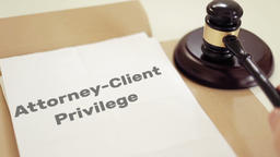 Attorney Client Privilege written on legal documents with gavel Footage