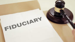 FIDUCIARY written on legal documents with gavel Footage