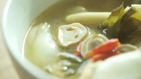 Thai Cuisine, Serving Tom Yam Squid Soup Footage