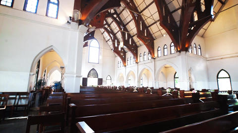 Church interior with wooden bench Footage