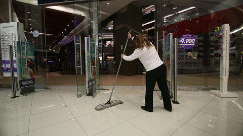Woman mopping store Footage