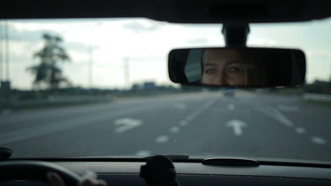 Reflection of lovely woman in car rear-view mirror Footage