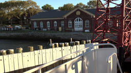 USA New York City Governors Island ferry boat departure in flat sunlight Footage