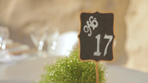 Black wedding numbered table stands with the number 17 Footage
