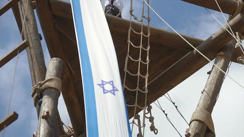 Israel flag hanged on wooden tower waving in the wind Footage