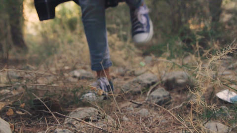 Closeup on little girl legs that walking in the forest Footage