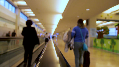 Blurred people moving on flat escalator inside airport terminal Footage
