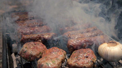 Barbecue beef kebabs cooking on hot grill Footage