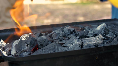 Coals are burned in a BBQ grill Footage