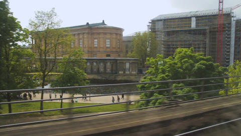 Buildings in the city of berlin from window view of a moving train Footage