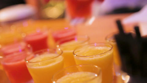 Many shot glasses with alcohol and citrus fruits juice Footage