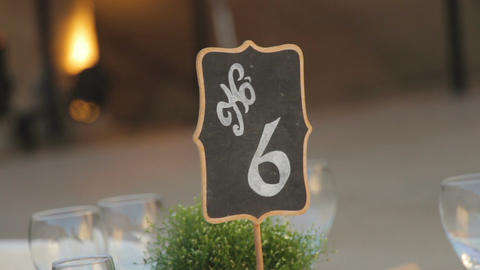 Black wedding numbered table stands with the number 6 Footage