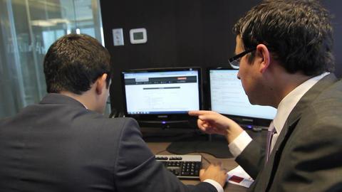 Men working at desks Footage
