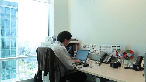 Working at desk near window Footage