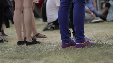Man on grass at music festival Footage
