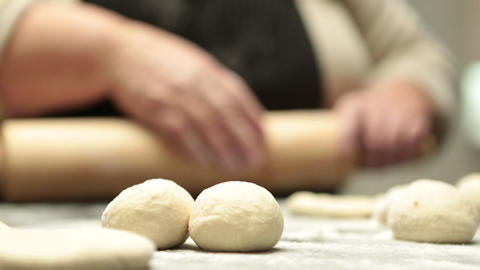 Woman flattening dough Footage