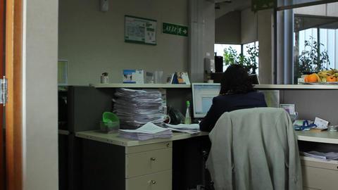 Sitting at desk Footage