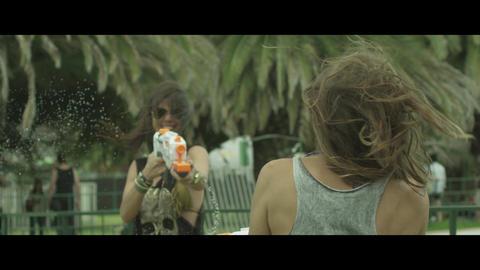 Woman sprays watergun Footage