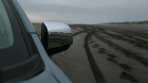 Car side mirror in sand Footage