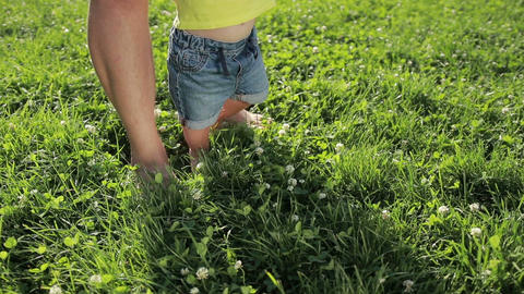 Father and baby boy feet walking barefoot on grass Footage