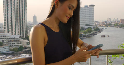 Pretty Thai Woman Texting Image