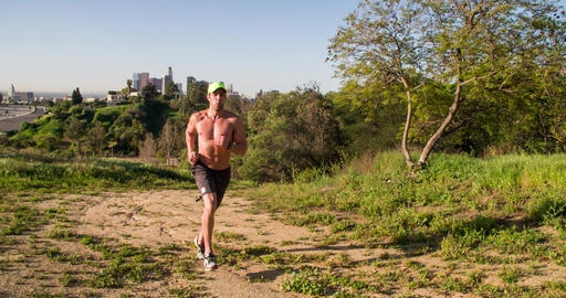 Athletic Male Trail Running Slow-Motion Footage