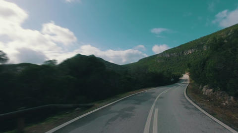 Speedy Driving on a Narrow Road in Mountains Footage