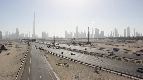 Iconic Dubai cityscape from desert area, road traffic lead to downtown Footage