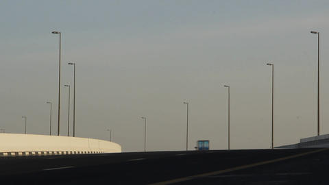 Abstract Arabic highway at evening sunlight, sparse traffic, car pass Footage