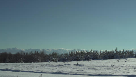 Snowy Mountains And Sun Panning 4K stock footage