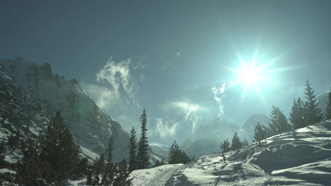 Clouds Rising to Snowy Mountain High Peaks 4K Footage