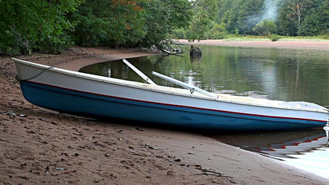 boat on the sandy shore of the river Footage