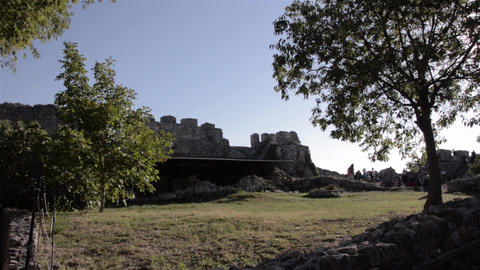 Group of tourists visit the ruins of an ancient fortress, admire the landscape y Footage