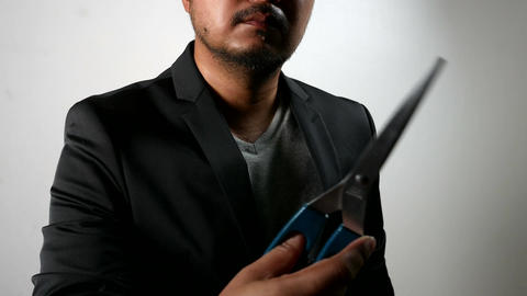 Businessman in Black Suit showing scissor in aggressive emotion Footage